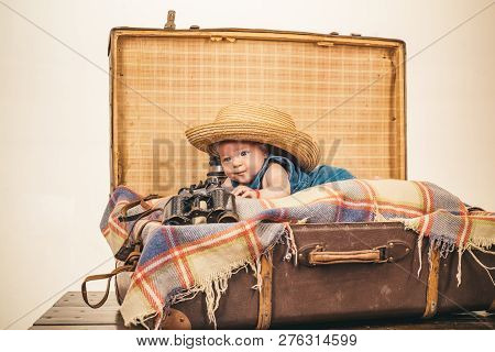 Joyful Mood. Family. Child Care. Small Girl In Suitcase. Traveling And Adventure. Portrait Of Happy