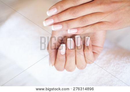 Woman Hand Care. Closeup Of Beautiful Female Hands Having Spa Manicure At Beauty Salon. Beautician F