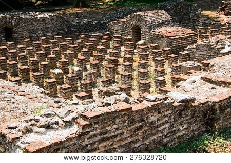 Ruins Of Roman Odeion And Thermae In Ancient Greece City Dion. Archaeological Park Of Sacred City Of
