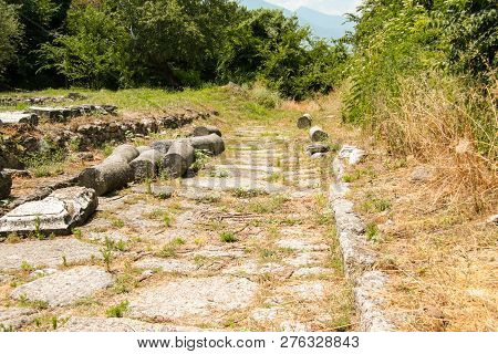 Ancient Greece City Dion. Remains Of The Ancient Main Road. Archaeological Park Of Sacred City Of Ma