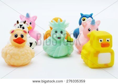 A Orange Rubber Duck With A Smile Face. A Pink Unicorn Rubber Duck. A Yellow Pixel Rubber Duck. An O