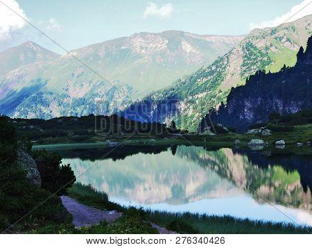 Alpine Lake Mittlerer Murgsee In The Glarus Alps Mountain Range - Canton Of St. Gallen, Switzerland