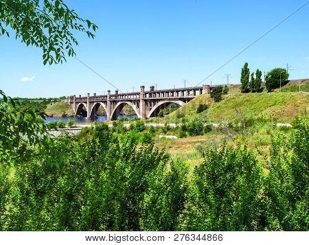 Arch Bridge Of Preobrazhensky Across The New Dnieper To Khortytsia Island In Zaporizhia. Beautiful F