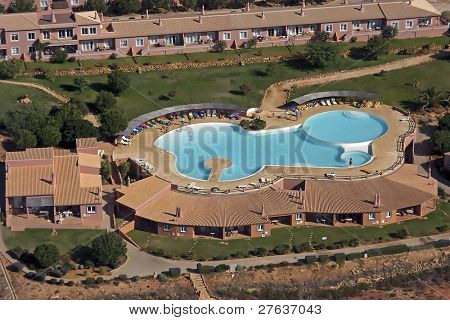 Bungalowcomplex with swimmingpool on the roof with skyview