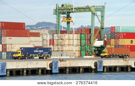 Oakland, Ca - October 27, 2018: Stacks Of Shipping Containers Line The Docks At The Port Of Oakland