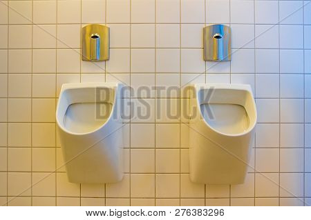 A urinal is a sanitary plumbing fixture for urination only. poster