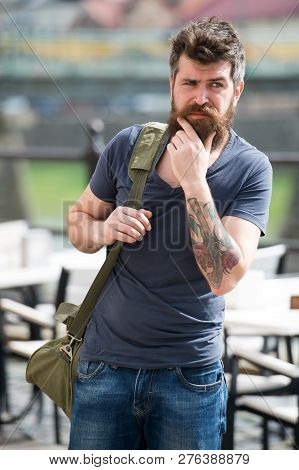 Looking For Accommodations. Hipster Thoughtful Traveler Carry Travel Bag. Business Trip. Man Bearded