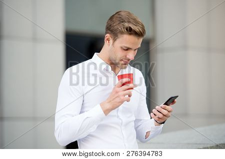Send Message. Man Drinks Coffee Read Message Urban Background. Start Great Day. Businessman Relaxing