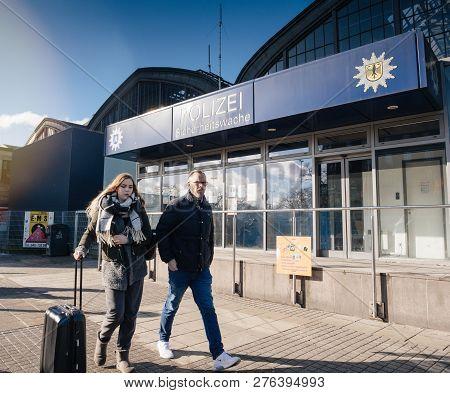 Hamburg, Germany - Mar 20, 2018: Man And Woman Passing By Police Polizei Station Near Hamburg Centra
