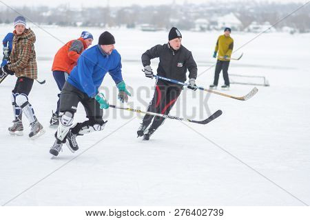 Dnipro, Ukraine - January 28, 2018: Group Active People Playing Hokey On A Frozen River Dnipro In Uk