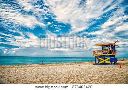 Lifeguard Tower For Rescue Baywatch On South Beach In Miami, Usa. Red And Blue Wooden House On Sea S