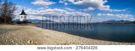 Pebble Beach And Lake Liptovska Mara, Slovakia. Panoramic Landscape