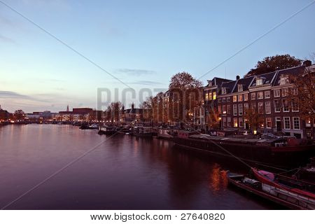 City scenic in Amsterdam innercity in the Netherlands at twilight