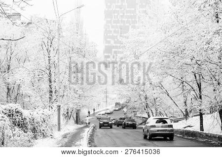 Kyiv, Ukraine-december 22, 2016: City Road Traffic In Winter, Transport. Cars Drive On Snow Covered