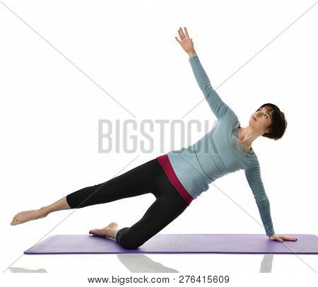 Female Fitness Instructor Doing Stretching For Hands Legs Abdominals Bar Exercise In Gym Work Out Is