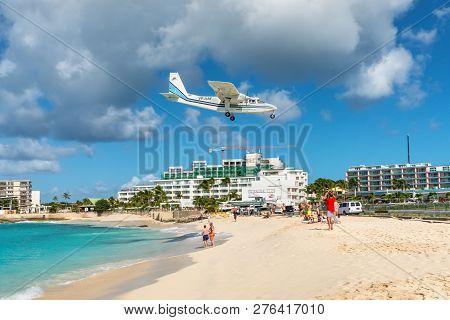 Simpson Bay, Saint Maarten - December 17, 2018: The Britten-norman Bn-2b-21 Islander Airplane Fly Ov