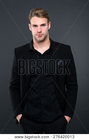 Black Fashion Trend. Man Elegant Manager Wear Black Formal Outfit On Dark Background. Reasons Black