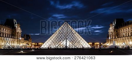 Paris - Sep 25, 2013: Louvre Museum At Night In Paris. Famous Louvre Is One Of Top Tourist Destinati