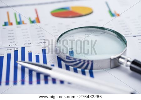 Magnifying Glass On Charts Graphs Spreadsheet Paper. Financial Development, Banking Account, Statist