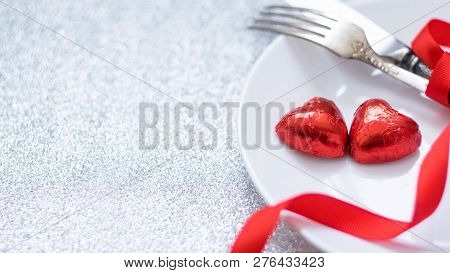 Valentine's Day Festive Table Setting With Two Red Heart Shape Chocolate Candies On White Plate, For