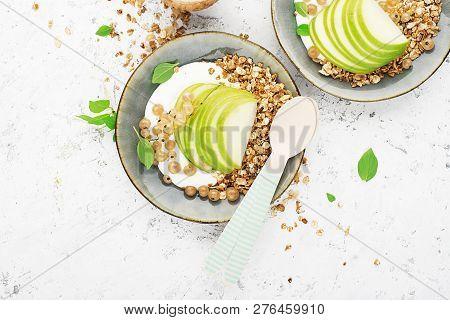 A Healthy Traditional Breakfast. Granola With Yoghurt, Green Apple, Yellow Currant, Fresh Flower Hon