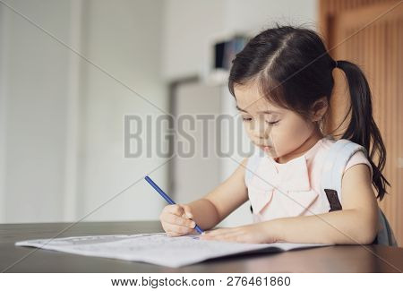 Back To School, Cute Little Girl Painting A Picture In Home, Girl Writing In Notebook With Pencil At