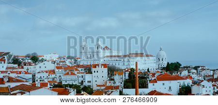 Scenery Of Lisbon. Panoramaview Of Alfama Old Town District On Cloudy Day, Lissabon, Portugal. Red-w