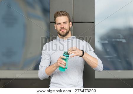 Thirsty Concept. Young Guy Look Thirsty. Thirsty Man Hold Water Bottle. A Drop Of Water Is Life For