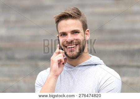 Talk Concept. Happy Man Talk On Mobile Phone. Young Guy Use Smartphone To Talk Outdoor. Carefree Tal
