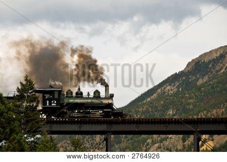 Steam Engine On A Mountain Bridge