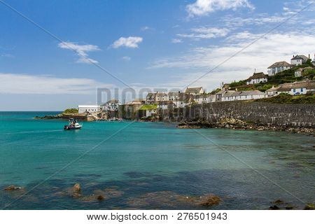 Coverack, Cornwall, Uk - July 2, 2016.  A View Of The Headland And Dollar Point From The Beach Of Th