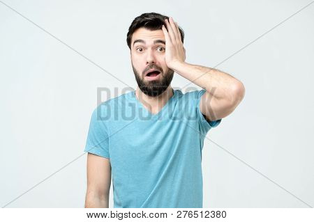 Puzzled Frustrated Male Looks With Bewilderment, Reacts On Sudden Message