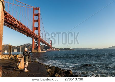 San Francisco, Usa - October 12, 2018: Fisherman With The Golden Gate Bridge In The Background At Fo