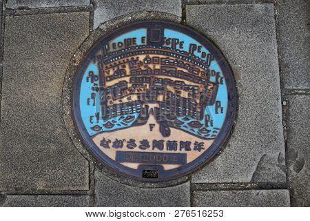 Nagasaki, Japan - October 25, 2018: Manhole cover art in Dejima, Nagasaki Prefecture.
