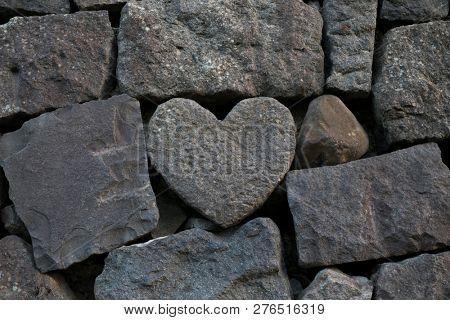 Nagasaki, Japan - October 24, 2018: Heart shaped stone in the wall of the dike of the Nagashima river, Nagasaki