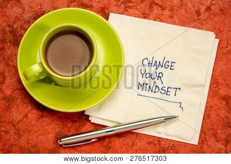 Change your mindset advice or reminder - handwriting on a napkin with a cup of coffee