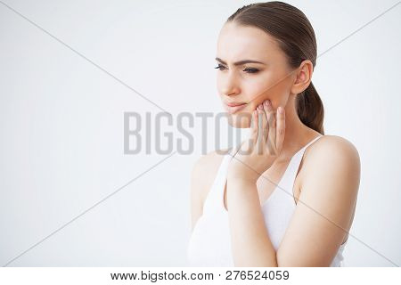Tooth Pain. Woman Feeling Tooth Pain. Closeup Of Beautiful Sad Girl Suffering From Strong Tooth Pain