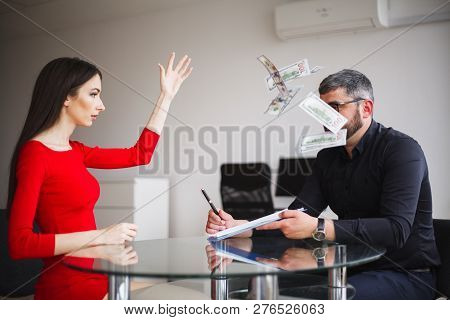 Business. Business Woman Gives Money To Men. Woman Dressed In Red Dress Gives Bribe. Business Man In