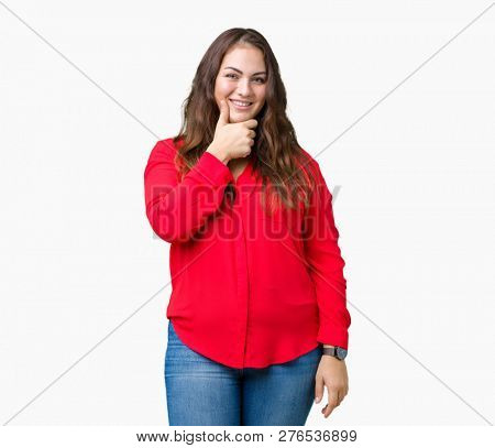 Beautiful plus size young business woman over isolated background looking confident at the camera with smile with crossed arms and hand raised on chin. Thinking positive.