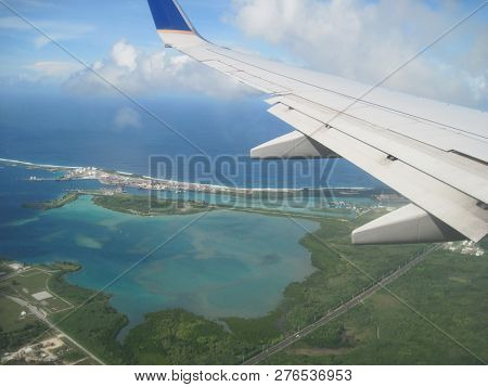 Left Wing Of An Airplane Over Guam Located In The Pacific Ocean