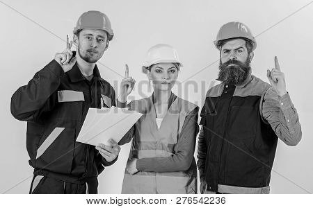 Builder And Engineer Found Out How To Solve Problem. Men In Hard Hats, Uniform And Woman. Team Of Ar