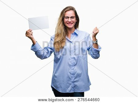 Young beautiful blonde business woman holding blank card over isolated background screaming proud and celebrating victory and success very excited, cheering emotion