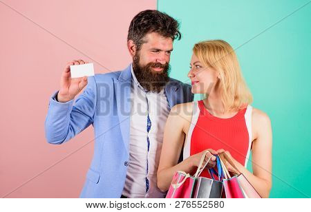 Paying While Dating. Couple With Luxury Bags In Shopping Mall. Man Bearded Hipster Hold Credit Card