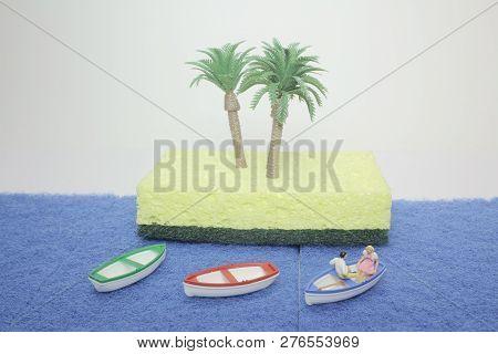 World In Mini  Figure. Boat On The Sea