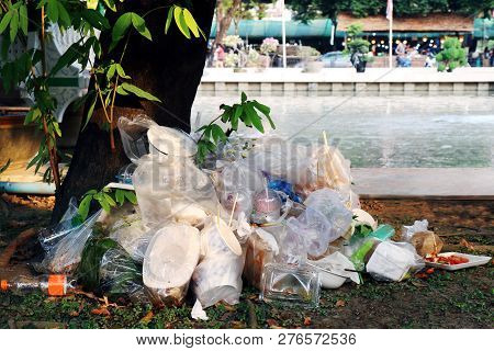 Waste Plastic Heap, Garbage Plastic, Waste Dump, Pile Plastic Bags And Wet Food Waste At The The Tre