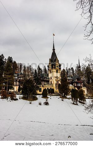 Peles Castle in a cloudy day of winter, the most famous royal castle of Romania, Romanian landmark. poster