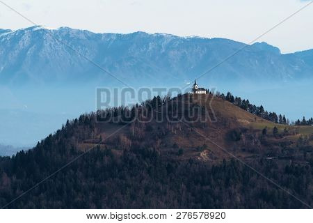St. Jacob Church On Top Of The Hill In The Dull Colors Of Winter In Slovenia. Religion, Hiking, Trav