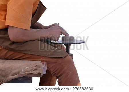 Potter uses a tool for create ceramic pot. Pottery and craftsmanship concept.  Isolated on white background. poster