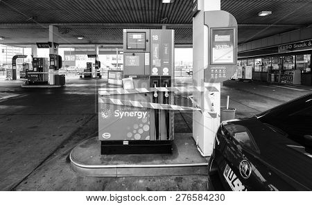 Kehl, Germany - December 27, 2018: Esso Gas Station With Cars Refueling In German Station Black And