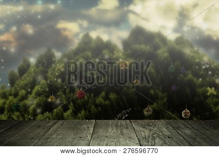 Rustic Wood Table In Front Of Christmas Tree In Snowy Landscape